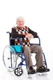 Cadeira de rodas do homem superior Fotografia de Stock Royalty Free