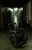 Cadeira de rodas velha Fotografia de Stock
