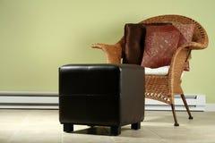 Cadeira de vime e otomano Fotos de Stock