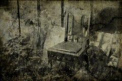 A cadeira do homem inoperante fotografia de stock