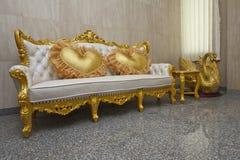 Cadeira do ouro Foto de Stock