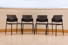 Cadeira do preto da leitura da faculdade Imagem de Stock