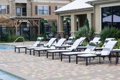 A cadeira do sol coberta com a neve em Texas Imagens de Stock Royalty Free