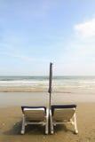 Cadeira dois na praia imagens de stock royalty free