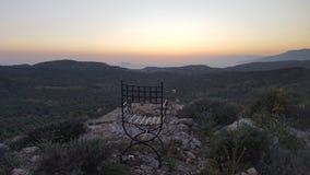 Cadeira em um monte Fotos de Stock