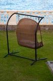 Cadeira Home do balanço por Mar Imagens de Stock Royalty Free