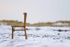 Cadeira lavada em terra Foto de Stock Royalty Free