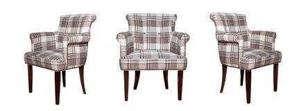 Cadeira moderna de matéria têxtil no teste padrão preto e branco da xadrez isolado Fotografia de Stock