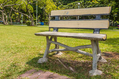 Cadeira no fundo Tailândia do jardim Imagens de Stock