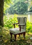Cadeira no lago Fotos de Stock
