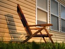 Cadeira no por do sol imagens de stock