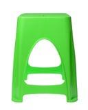 Cadeira plástica verde suja isolada no branco imagem de stock royalty free