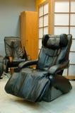 Cadeira preta da massagem Fotos de Stock Royalty Free