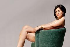 Cadeira verde e um modelo Fotografia de Stock Royalty Free