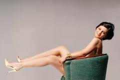 Cadeira verde e um modelo Fotos de Stock