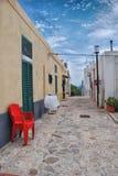 Cadeira vermelha na maneira Imagem de Stock Royalty Free