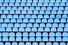 Cadeiras azuis do estádio Fotografia de Stock Royalty Free