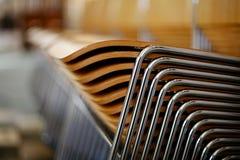 Cadeiras de madeira empilhadas Imagens de Stock