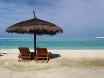 Cadeiras de plataforma na praia Imagem de Stock Royalty Free