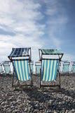 Cadeiras de plataforma no beira-mar Fotografia de Stock