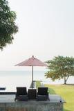 Cadeiras de praia com árvore Imagens de Stock Royalty Free
