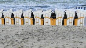 Cadeiras de praia no mar Báltico Imagens de Stock