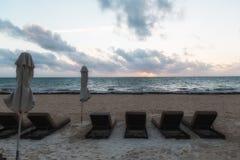 Cadeiras de praia no nascer do sol fotografia de stock royalty free