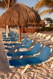 Cadeiras de praia no Sun fotografia de stock royalty free