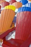 Cadeiras do assento da cor na neve Foto de Stock Royalty Free