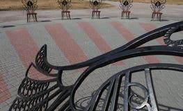 Cadeiras do relógio de sol imagens de stock