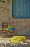 Cadeiras e redes de pesca Fotos de Stock