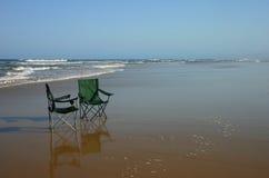 Cadeiras na praia Imagem de Stock