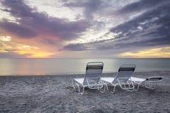 Cadeiras no por do sol Fotografia de Stock