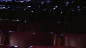 Cadeiras vazias do cinema video estoque