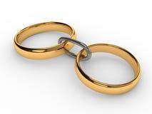 Cadena conectada de los anillos de oro de la boda Fotos de archivo