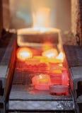 Cadena de producción caliente del engranaje de la forja Fotografía de archivo libre de regalías