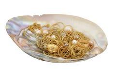 Cadenas de oro y anillos Foto de archivo libre de regalías