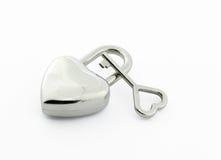 Cadenas en forme de coeur et clé Photographie stock