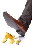Cadendo su una pelle di banana Fotografia Stock Libera da Diritti