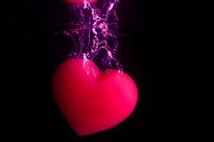 Cadere rosso del cuore Fotografia Stock