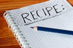 Caderno aberto com um registro da receita Fotos de Stock Royalty Free