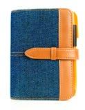 Caderno azul da sarja de Nimes com pena Fotografia de Stock