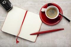 Caderno, café e telefone imagens de stock royalty free