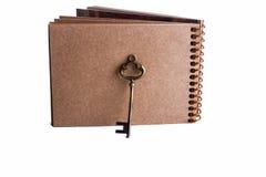 Caderno chave e espiral Fotos de Stock