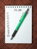 Caderno com estilete fotos de stock