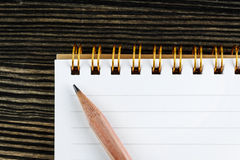 Caderno com lápis Fotos de Stock Royalty Free