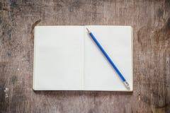 Caderno com lápis Imagens de Stock