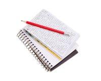 Caderno com lápis vermelho Imagem de Stock