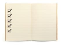 Caderno com lista de verificação Fotografia de Stock Royalty Free