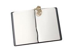 Caderno com marcador do ouro Foto de Stock